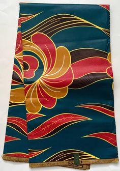 House of Mami Wata African Print Fabrics  https://www.etsy.com/listing/573147648/african-print-fabric-ankara-teal-caramel