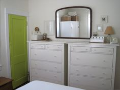 Such a great idea! 2 dressers side by side, mirror in the middle to make it look uniform.