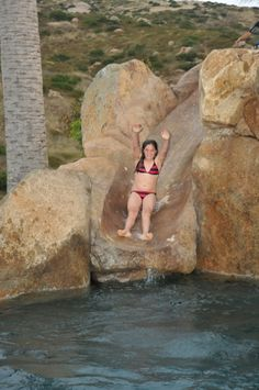 Concrete water slide winds through boulders...