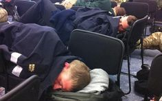 'Getting their heads down': A photograph posted on Twitter showing troops from HMS Northumberland grabbing some much-needed shut-eye on chairs between shifts after being called in to protect the Olympics. These boys are securing the Olympics for us.