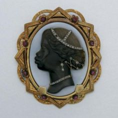 GOLD, HARDSTONE BLACKAMOOR CAMEO HABILLÉ, RUBY, DIAMOND AND ENAMEL BROOCH, MID-19TH CENTURY