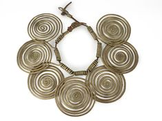 Necklace |  Alexander Calder.   Brass Spirals on a leather strap