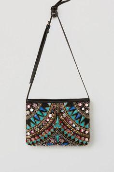 c5cff723967e The fanciful Esmeralda Crossbody Bag bears an intricate design. Vertically  symmetrical
