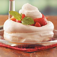 """Meringue Nests Recipe -These crunch meringue shells will have guests """"oohing"""" and """"aahing."""" Topped with your favorite fresh fruit, they're pretty served with a spring meal.—Taste of Home Cooking School, Greendale, Wisconsin"""