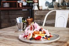 The Tiny Giant / You'll see it stationed on every other table, and all over Instagram. And there are good reasons why the brioche piled with fruit, flowers and hot-pink fairy floss is the pin-up-pretty number that everyone wants to order at this Petersham café. Yes, it's designed to rack up double taps and approving emojis, but this dish is actually delicious. Served like French toast, the brioche slices are dusted with crumbled pistachio and partly sealed with mascarpone. A ring of mixed…