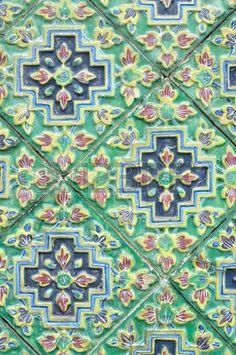 Ancent Ceramic tile decorated with Thai art photo