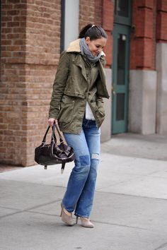 At the beginning of the year, Katie Holmes looked cozy and cool in an army jacket with a fuzzy shearling collar. She completed her ensemble with '70s-style jeans, taupe booties, and a striped gray scarf.