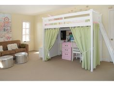 The lofted bed with curtained study nook is perfect for a young girl's #bedroom. /The girls would love this in their room!
