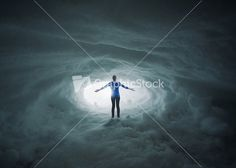 Download A woman lost in a snow cavern with her arms in praise. Stock Image and other stock images, photos, icons, vectors, backgrounds, textures and more.