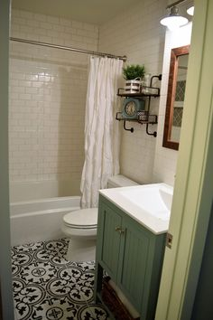 Black and white cement (look) tile at a fraction of the cost. Small bathroom remodel on a budget.