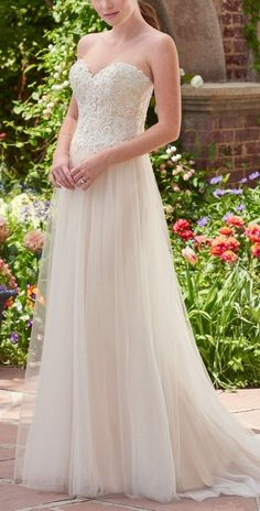 Chelsea wedding dress by Rebecca Ingram features a sweet beaded bodice atop ballerina-inspired skirt. Affordable and chic = match made in heaven.