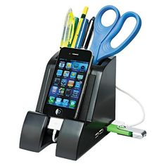 Designed to fit any smartphone, e-reader, or tablet, the Smart Charge Pencil Cup keeps your device handy, while keeping pens, pencils and other utensils close at hand. Angled front provides an excellent ergonomic viewing platform for any size mobile device. Includes four USB ports to charge your phone or connect to your computer allowing data transfer from flash drives, phones and other devices. Access channels under the base keep cables in place while the rear cord keeper stores extra cable…