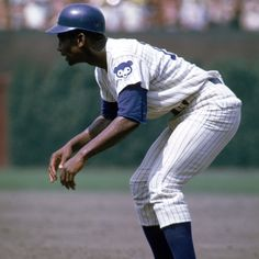 Ernie Banks waits to steal a base.