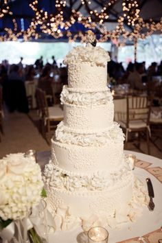 all . white . detailed . wedding . cake