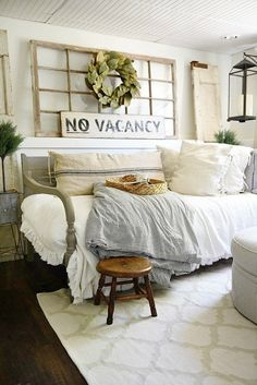Cozy day bed with a white comforter and pillows paired with a stormy blue throw.
