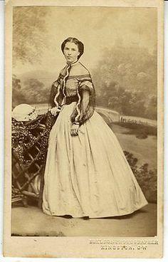 Sheer over-blouse worn over a ball gown - creates an evening/dinner dress