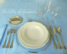 The Table of Flavours gives the 5 Basic Rules for a formal table setting.  Notice the number of utensil's and glasses at this table setting.