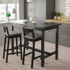 NORDVIKEN Bar stool with backrest, black. Our super comfy NORDVIKEN bar stool with deepening in the seat and curved backrest keeps the conversation going until you ask the guests to leave. A perfect match with NORDVIKEN bar table. Bar Table Ikea, A Table, High Bar Table, Bar Height Dining Table, Ikea High Table, High Table Kitchen, Tall Dining Room Table, Bar Top Tables, Space Saving Dining Table