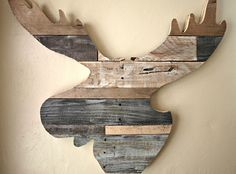 Exciting Moose Head Wood Art On The Cream Bedroom Wall
