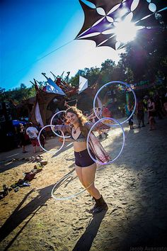 """Becca Goldberg Spins Serenity. Becca """"Bex"""" Goldberg is spinning up multiple hula hoops at the Serenity Gathering. Photo by Jacob Avanzato."""
