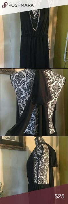 NWOT XL Black Backless Jumpsuit Can be dressed down or dressed up! In like new condition! Never worn!  Size XL.   Has long, wide self tie straps. Elastic waist. Low, open back. Fabric had a stretchy jersey type feel. Full length legs with wide legs so the fabric is flowy. Very comfortable and sexy!  Not my pictures! Other
