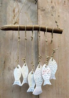 White Textured Porcelain Fish, Suspended by Twine from a Branch