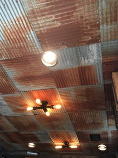 A majority rust tin ceiling installation