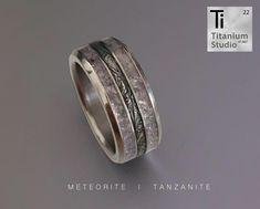 Titanium men's ring with Meteorite centre and crushed tanzanite gemstone inlay Tanzanite Gemstone, Gemstones, Titanium Rings, Wedding Bands, Centre, Rings For Men, Watches, Jewelry, Wrist Watches