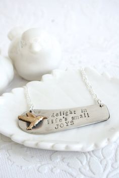 This unique pendant is made from a vintage silver plated butter knife that was cut down, sanded and drilled. It was hand stamped with the saying,