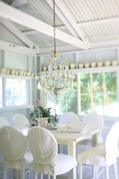 whites summer porch... Like the white flower pots above the windows. Use Idea in my sunroom