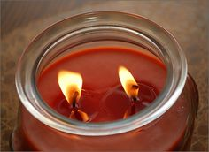 How to Make Your Own Scented Candles--lots of tips for making candles and using up leftover wax