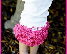 A fun and new creation unlike any other bloomer! Faith Baby has created a unique twist to the original ruffled bloomer that our mothers loved to wear. Designed with style and grace this trendy ruffled baby bloomer has an abundance of fluffy ruffles that halo a Hot Pink woven bloomer. A fun and frilly look for any day of the week!All of our ruffled baby bloomers are proudly made in the USA