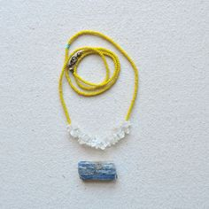 sure crystal necklace with dirty yellow beads, $27