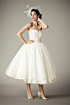 Kinda like the idea of  tea length wedding dress