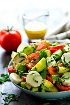 This Italian-style tomato avocado salad is loaded with tons of fresh tomatoes, avocados, cucumbers, and soft mozzarella cheese for one killer summer salad! Avocado Tomato Salad, Avocado Salat, Cucumber, Bbq Salads, Summer Salads, Avocado Recipes, Healthy Salad Recipes, Mozzarella, Cobb