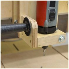 A wooden router table that allows for quick drilling, routing, and 2D and 3D milling jobs when a CNC machine is overkill.
