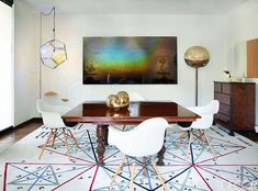 Eames chairs surround a 19th-century Mexican table in the dining room; a light fixture by Olafur Eliasson and a sculpture by Yishai Jusidman flank a painting by Rubén Ortiz-Torres, and the rug by Jose Dávila was inspired by R. Buckminster Fuller.   Contemporary Decor   Boca do Lobo   Inspiration and News in www.bocadolobo.com/en