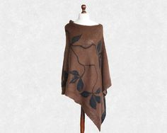 Brown and black knit poncho with felt application large size, hand made ready to ship. $120.00, via Etsy.