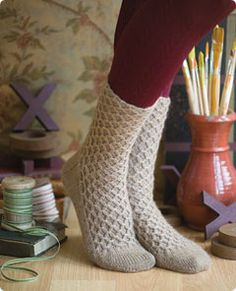 Smocked socks. Free pattern from Vogue Knitting.