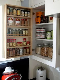 Mounted Cabinet Door Spice Rack with Dowel Guard Rails. One of 19 CLEVER Storage Ideas that Help Organize Food in the Pantry, Kitchen Cabinets, and Freezer.