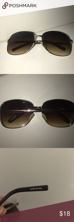 Steve Madden sunglasses. Only worn a few times. No scratches or marks on them. Adjustable nose pieces. Brown lenses and a metallic tan color on the the rest of the glasses. Steve Madden Accessories Glasses