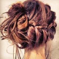Thinking some sort of messy side bun with a braid