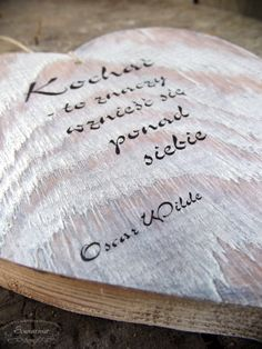 Heart made from reclaimed wood, with love-related quote.