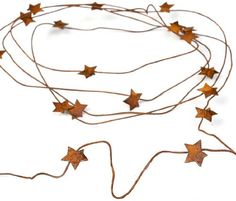 Primitive 6 Foot Long Dangling Rusty Star Wire Garland for Indoor and Outdoor Decor Package of 4 Garlands -- Read more  at the image link.