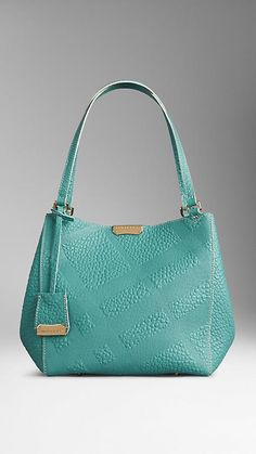 The Burberry Small Canter in Bonded Leather in Aqua Green. A tote bag in signature grain leather with embossed check panels, bonded to contrast colour nappa leather at the interior. Discover women's bags at Burberry.com