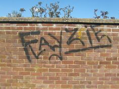 Took a picture of a wall with Fayzie on it
