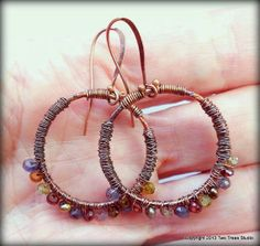 Round multicolored gemstone earrings wrapped in antique copper, light and airy, with plenty of sparkle--elegant with a touch of Boho.  By Two Trees Studio, $34.