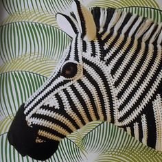The direction of the zebra's stripes is determined by the shaping of the head, crocheted in rounds and short rows. The mane is made by attaching tassels to the stitches and brushing through the yarn to tangle the fibres and help it stand on end. Beau Crochet, Crochet Art, Crochet Home, Love Crochet, Crochet Animals, Crochet Patterns, Crochet Taxidermy, Faux Taxidermy, Knitting Projects
