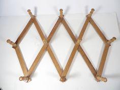 Vintage Accordion Expandable Peg Rack - Wood Folding Peg Rack by MonochromeVintage on Etsy https://www.etsy.com/listing/540135863/vintage-accordion-expandable-peg-rack