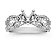 This modern design features 94 round pavé-set diamonds at approximately .38 carat total weight. The quality 14 karat white gold split shank setting pulls the look together.